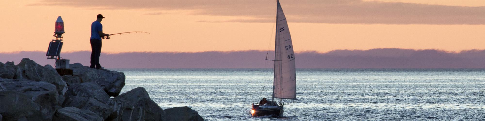 Sailboat, fisherman, by the sea
