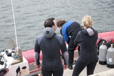 Person on a boat, getting ready to scuba dive