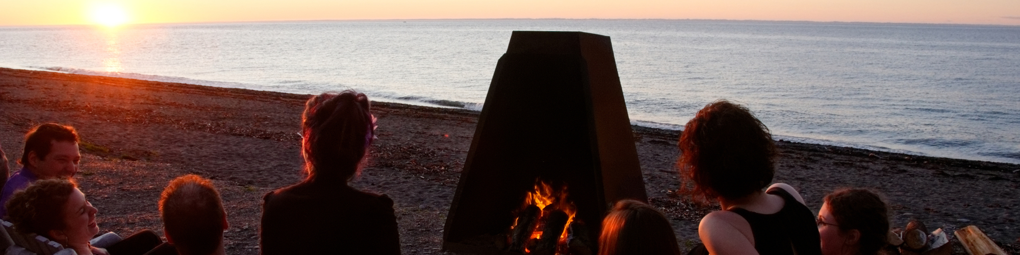 People around a bonfire, sunset