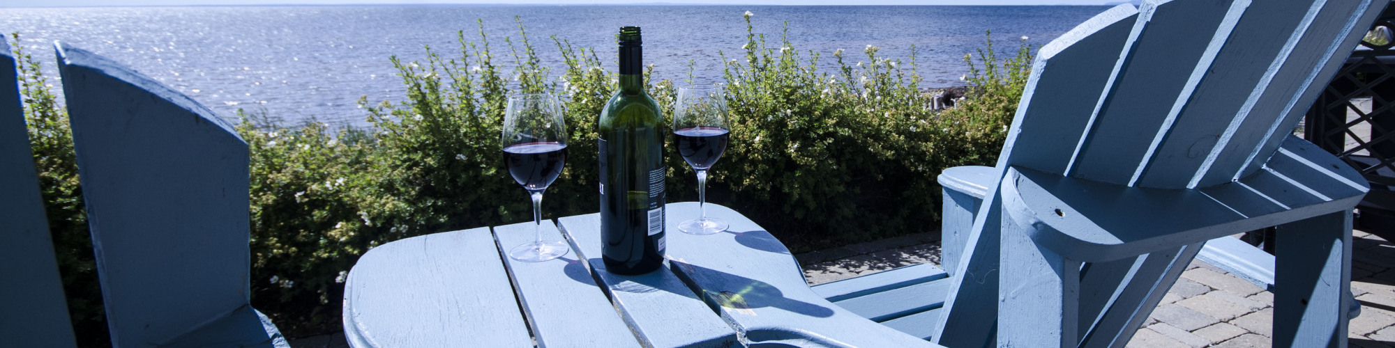 Aperitif by the sea, 2 chairs on a terrace, wine