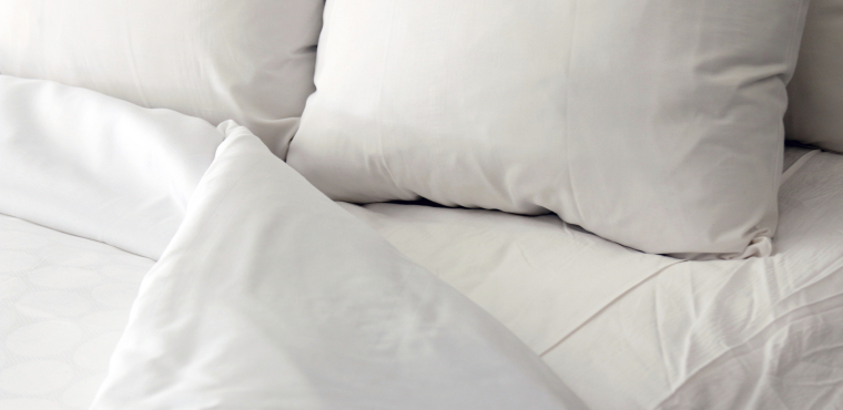 White bed, pillows and duvet