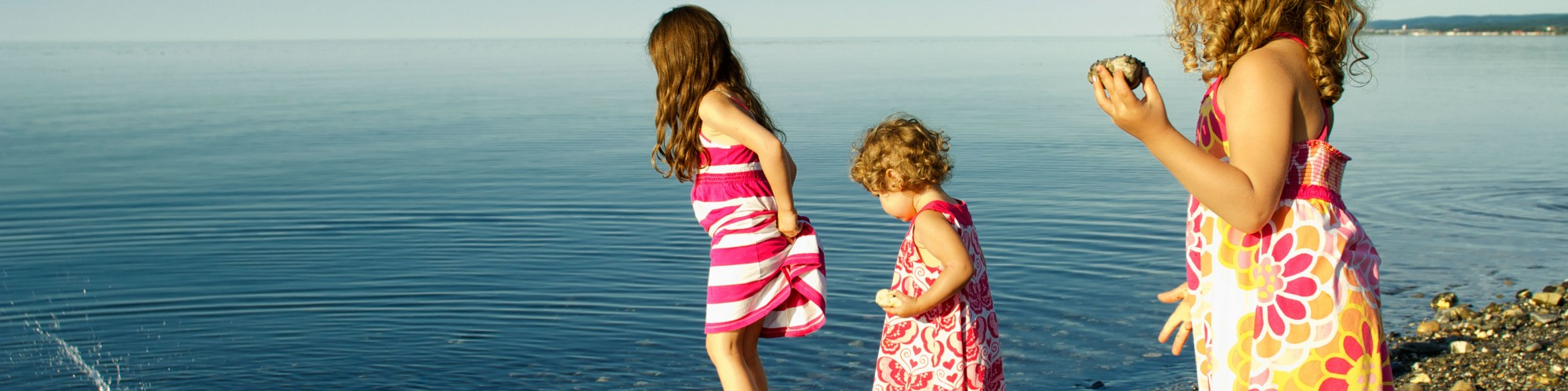 3 little girls playing in the water, on the beach