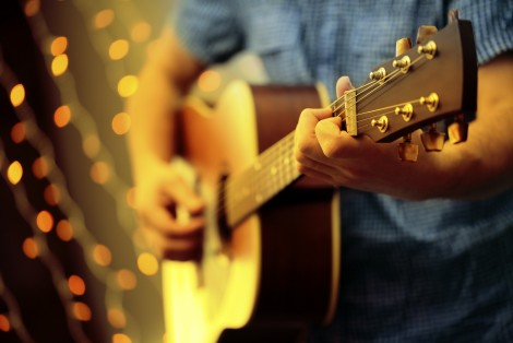 Man playing guitar, event, evening