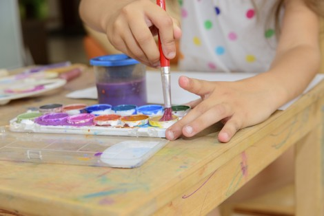 Child painting with watercolours
